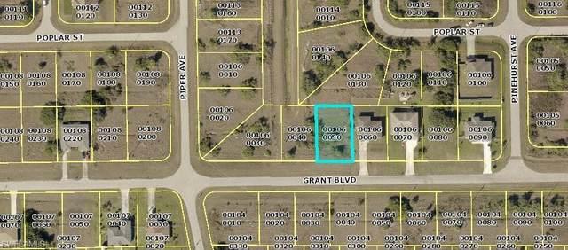 409 Grant Boulevard, Lehigh Acres, FL 33974 (MLS #221043939) :: #1 Real Estate Services