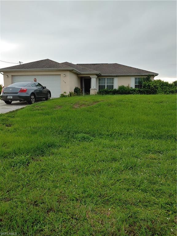 310 Patio St, Lehigh Acres, FL 33974 (MLS #219050038) :: Sand Dollar Group