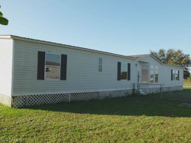 1813 Matthew Loop, Clewiston, FL 33440 (#219080036) :: The Dellatorè Real Estate Group