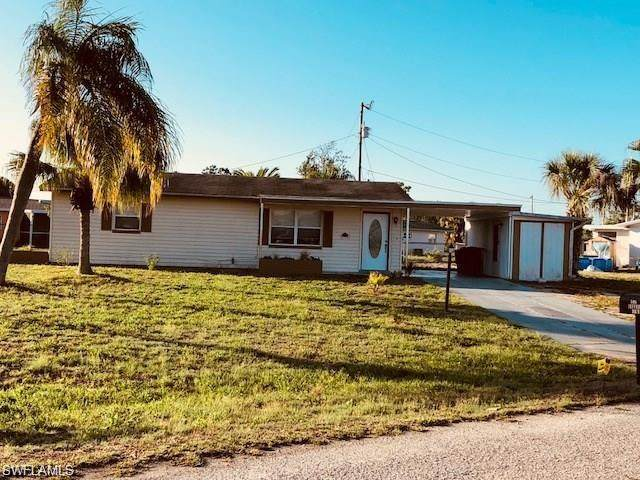 506 Jefferson Dr, Lehigh Acres, FL 33936 (#220015044) :: The Dellatorè Real Estate Group