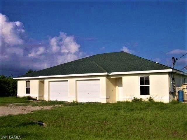 328/330 Harold Avenue S, Lehigh Acres, FL 33973 (#220049476) :: The Dellatorè Real Estate Group