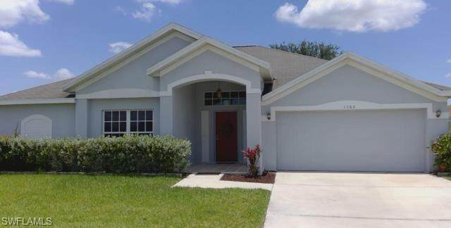 1504 Fieldhouse Court, Lehigh Acres, FL 33971 (#220065994) :: The Dellatorè Real Estate Group