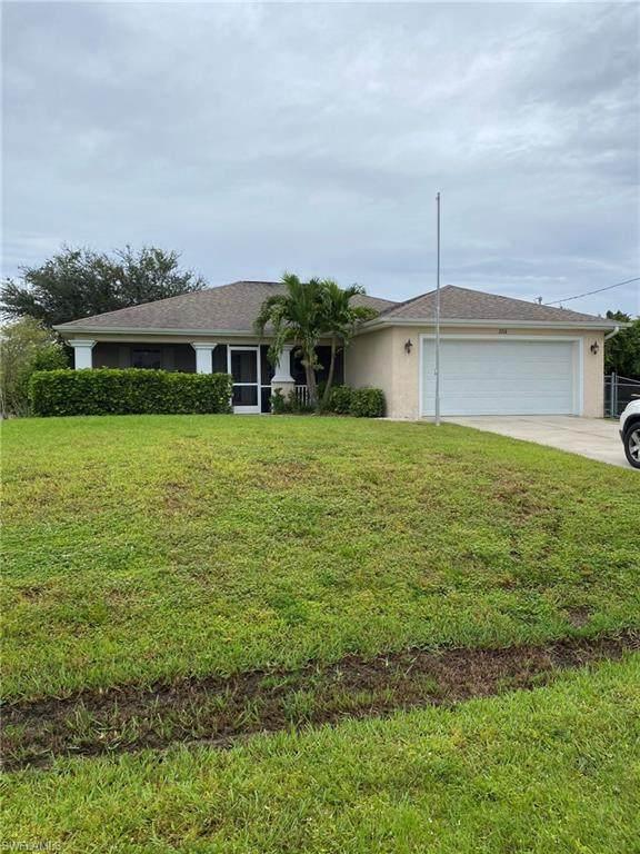 3716 12th Street SW, Lehigh Acres, FL 33976 (#220067212) :: The Dellatorè Real Estate Group