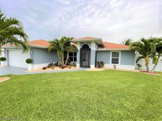 1020 NW 36th Place, Cape Coral, FL 33993 (MLS #221044831) :: The Naples Beach And Homes Team/MVP Realty
