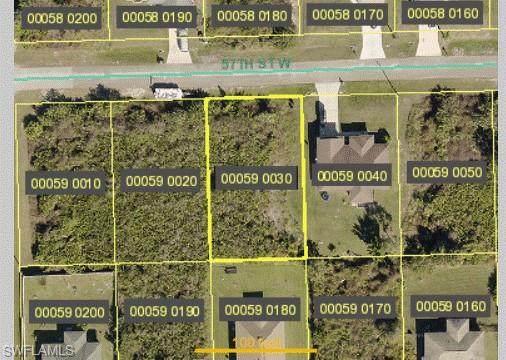 2715 57th Street W, Lehigh Acres, FL 33971 (MLS #221053835) :: The Naples Beach And Homes Team/MVP Realty
