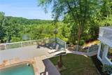 9485 Huntcliff Trace - Photo 54