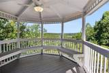 9485 Huntcliff Trace - Photo 44