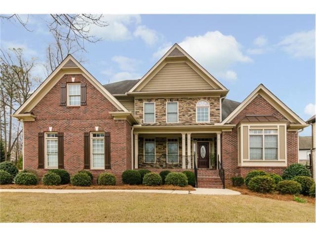302 Stillwater Cove, Woodstock, GA 30188 (MLS #5825689) :: North Atlanta Home Team