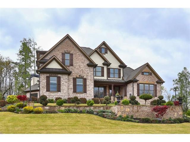 7010 Collins Point Road, Cumming, GA 30041 (MLS #5830387) :: North Atlanta Home Team