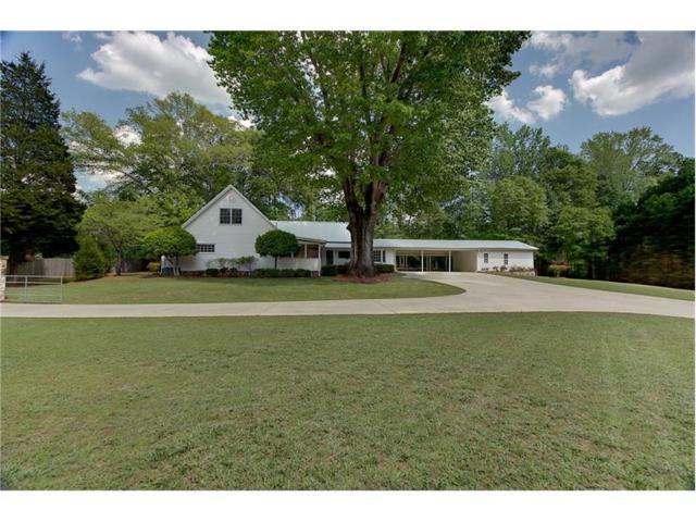 1165 W Wylie Bridge Road, Woodstock, GA 30188 (MLS #5837773) :: North Atlanta Home Team