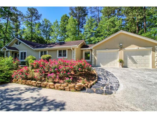 5030 Carriage Lakes Drive NE, Roswell, GA 30075 (MLS #5847372) :: North Atlanta Home Team
