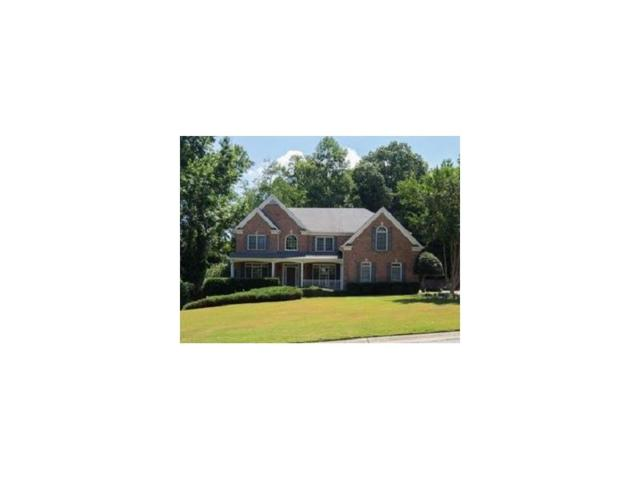 1405 Woodland Trace, Cumming, GA 30041 (MLS #5854862) :: North Atlanta Home Team