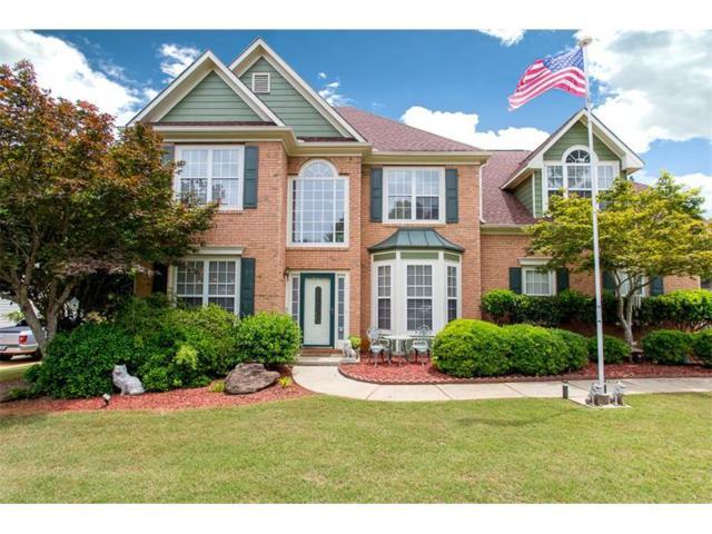 5009 Weatherstone Drive, Buford, GA 30519 (MLS #5855892) :: North Atlanta Home Team