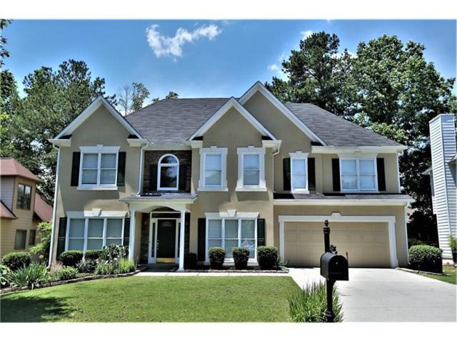 585 Oakmont Hill, Johns Creek, GA 30097 (MLS #5859960) :: North Atlanta Home Team
