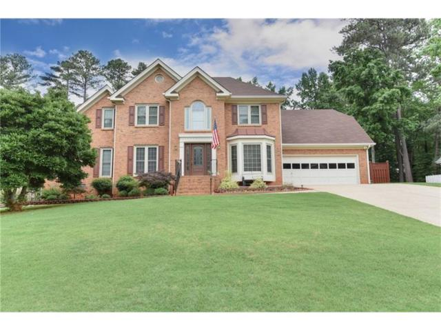 311 Shore Drive, Suwanee, GA 30024 (MLS #5861392) :: North Atlanta Home Team