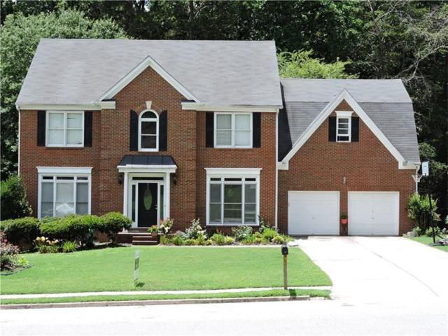 4597 Cedar Wood Drive SW, Lilburn, GA 30047 (MLS #5868497) :: North Atlanta Home Team
