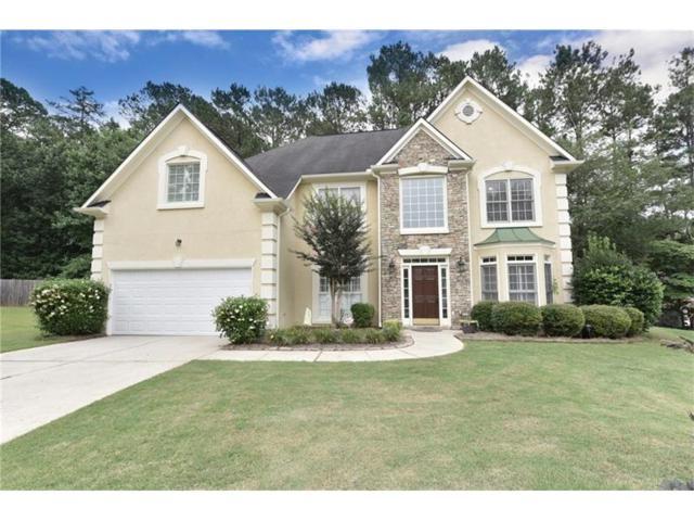 4510 Red Cedar Cove SW, Lilburn, GA 30047 (MLS #5868808) :: North Atlanta Home Team