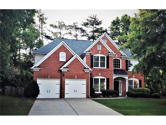 335 Woods Lane, Johns Creek, GA 30005 (MLS #5870620) :: North Atlanta Home Team