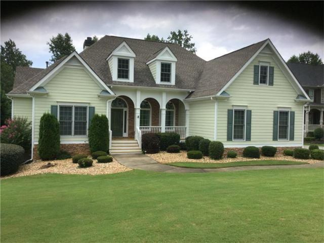 5050 Magnolia Creek Drive, Cumming, GA 30028 (MLS #5873342) :: North Atlanta Home Team