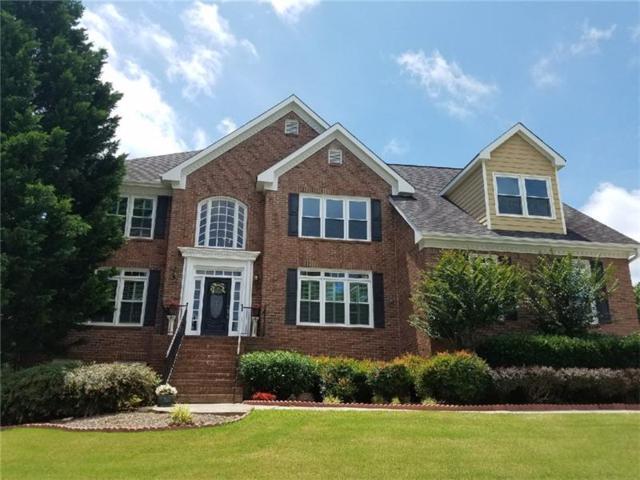 1395 Country Lake Drive, Lilburn, GA 30047 (MLS #5873544) :: North Atlanta Home Team