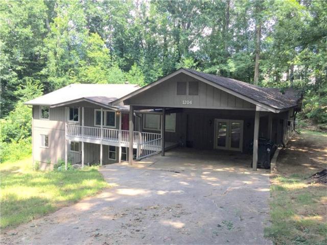 1204 Rolling Oaks Drive NW, Kennesaw, GA 30152 (MLS #5879522) :: North Atlanta Home Team