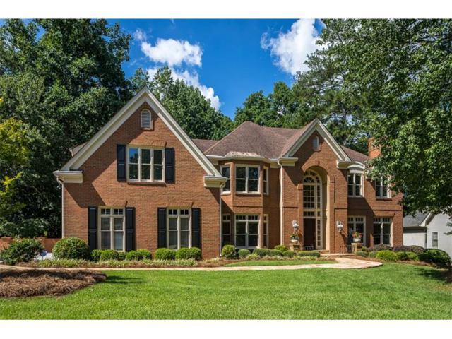 135 Grogans Lake Drive, Sandy Springs, GA 30350 (MLS #5880480) :: North Atlanta Home Team
