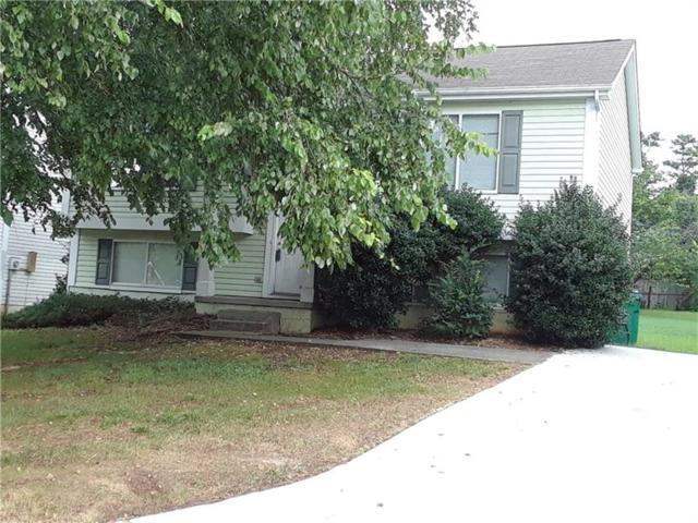 6107 Raintree Bend, Lithonia, GA 30058 (MLS #5883796) :: North Atlanta Home Team