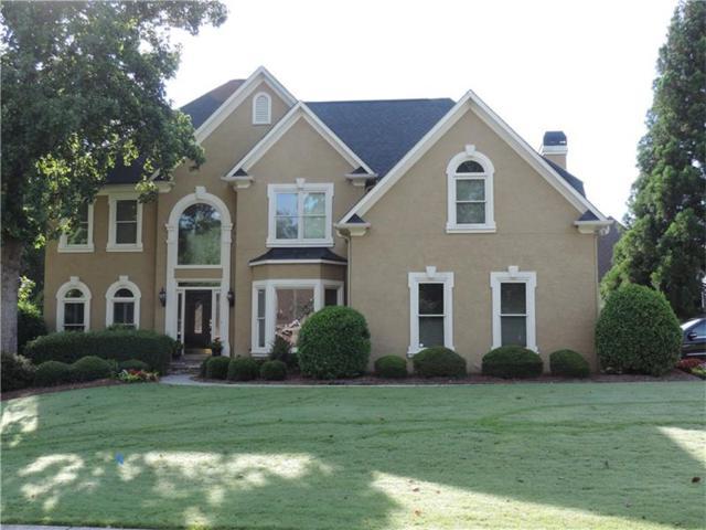 7001 E Hills Way, Woodstock, GA 30189 (MLS #5886964) :: North Atlanta Home Team