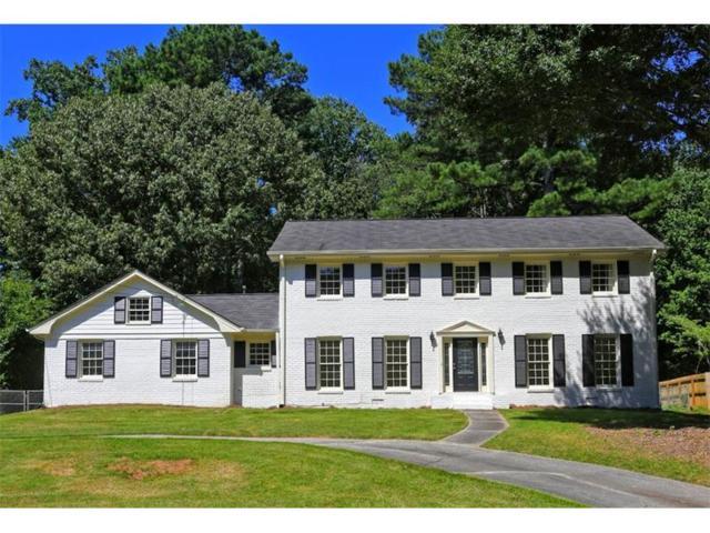 2477 E Kings Point Drive, Dunwoody, GA 30338 (MLS #5891261) :: North Atlanta Home Team