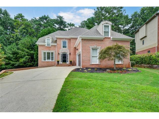 5055 Winding Hills Lane, Woodstock, GA 30189 (MLS #5893384) :: Path & Post Real Estate