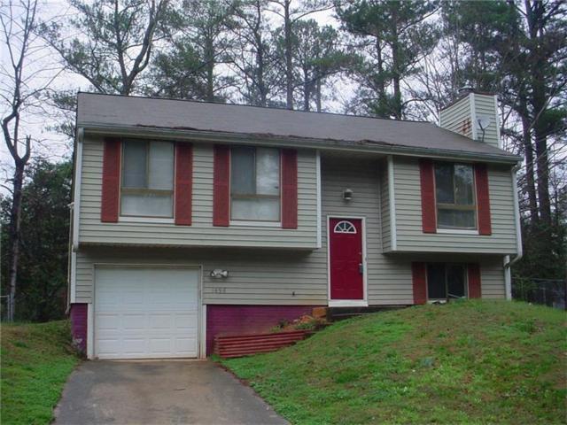 1498 Muirfield Drive, Stone Mountain, GA 30088 (MLS #5898695) :: Carrington Real Estate Services