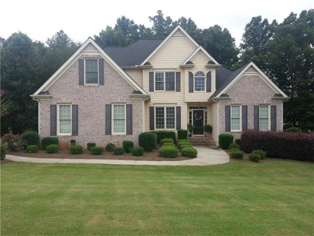 4820 Magnolia Creek Drive, Cumming, GA 30028 (MLS #5903314) :: North Atlanta Home Team