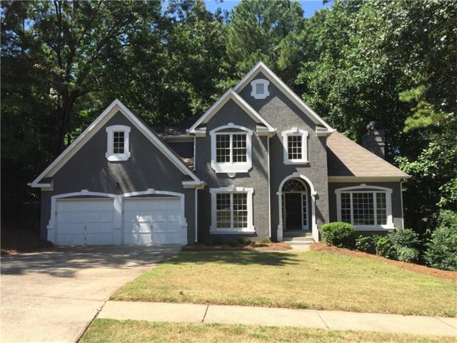 407 Beechwood Lane, Woodstock, GA 30189 (MLS #5905811) :: North Atlanta Home Team