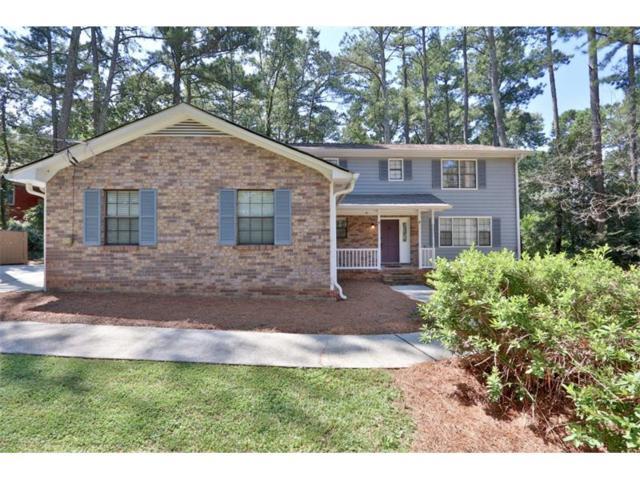 3885 Hunting Ridge Drive SW, Lilburn, GA 30047 (MLS #5907040) :: North Atlanta Home Team