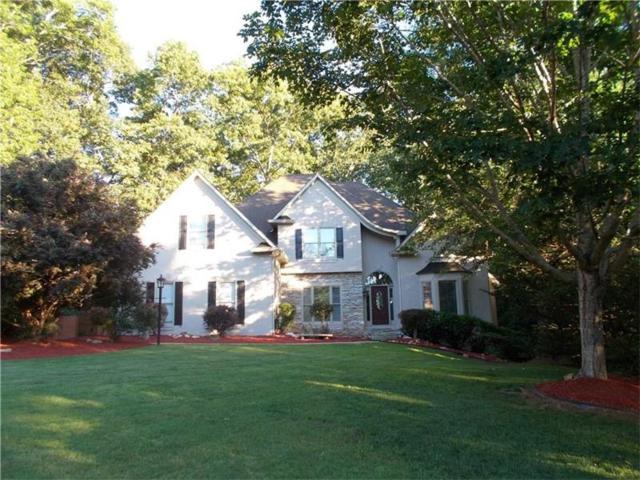 318 Quiet Hill Lane, Woodstock, GA 30189 (MLS #5914633) :: North Atlanta Home Team