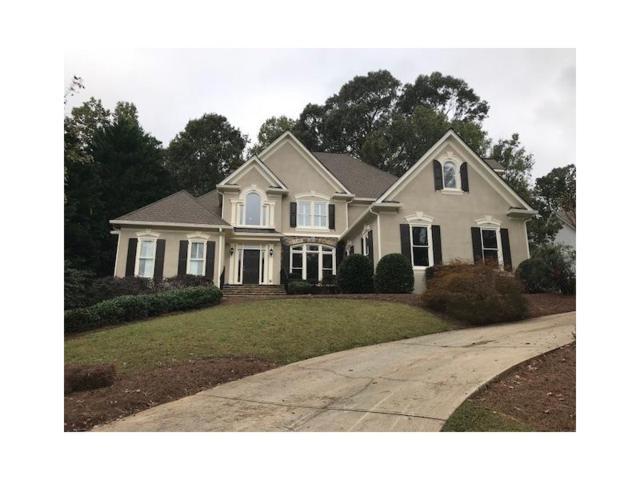 5565 Stoneleigh Drive, Suwanee, GA 30024 (MLS #5921070) :: North Atlanta Home Team