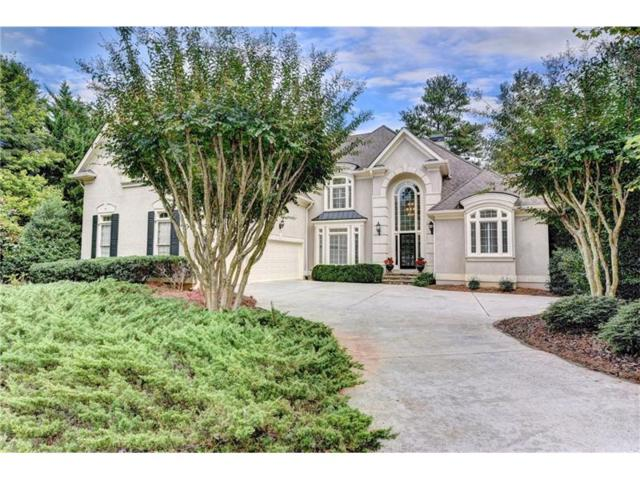 5590 Stoneleigh Drive, Suwanee, GA 30024 (MLS #5921134) :: North Atlanta Home Team