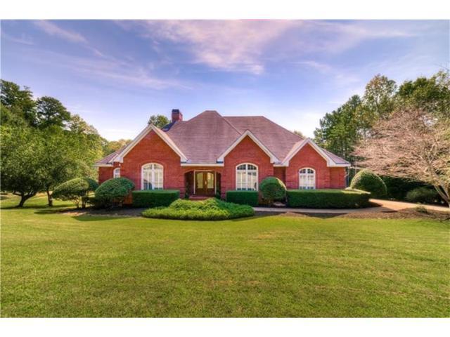 657 Garrison Trail, Canton, GA 30115 (MLS #5922003) :: Path & Post Real Estate
