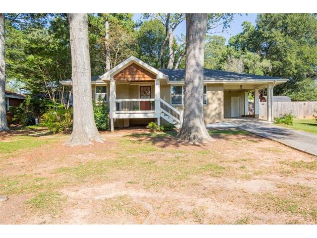 1015 Magnolia Drive SE, Smyrna, GA 30082 (MLS #5923728) :: Carrington Real Estate Services
