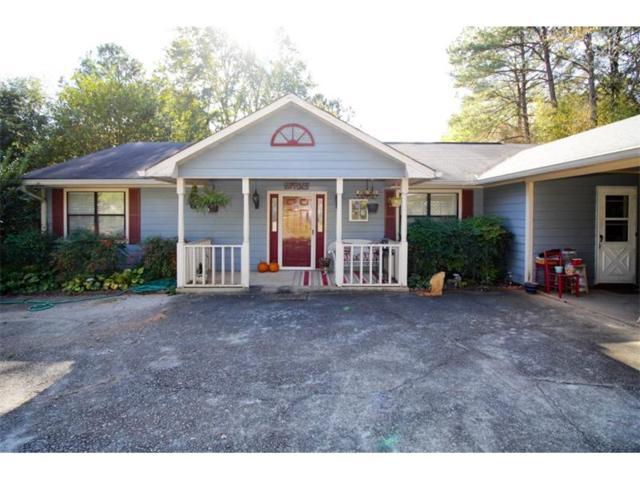 671 W Johns Road NW, Lilburn, GA 30047 (MLS #5926742) :: North Atlanta Home Team