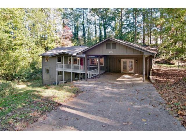 1204 Rolling Oaks Drive NW, Kennesaw, GA 30152 (MLS #5928808) :: North Atlanta Home Team