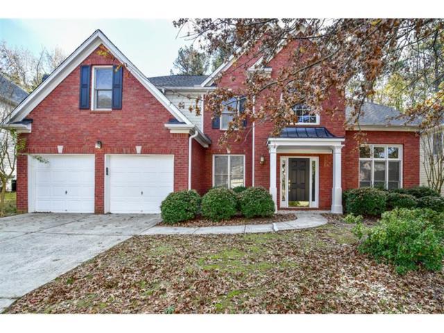 2477 W Madison Drive, Dunwoody, GA 30360 (MLS #5934594) :: Buy Sell Live Atlanta