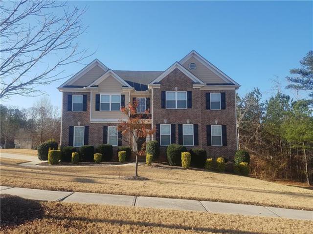 7921 The Lakes Drive, Fairburn, GA 30213 (MLS #5950447) :: North Atlanta Home Team