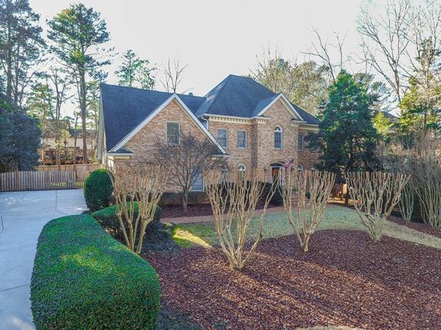 7585 S Spalding Lake Drive, Sandy Springs, GA 30350 (MLS #5957141) :: North Atlanta Home Team