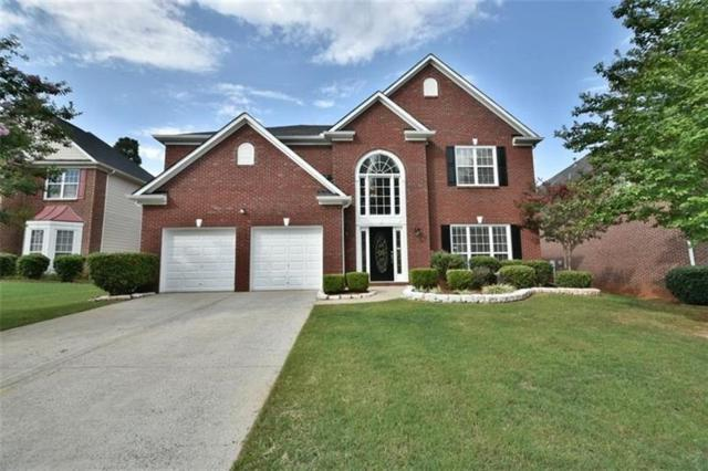 585 Maple Crest Drive, Lawrenceville, GA 30044 (MLS #5967666) :: North Atlanta Home Team