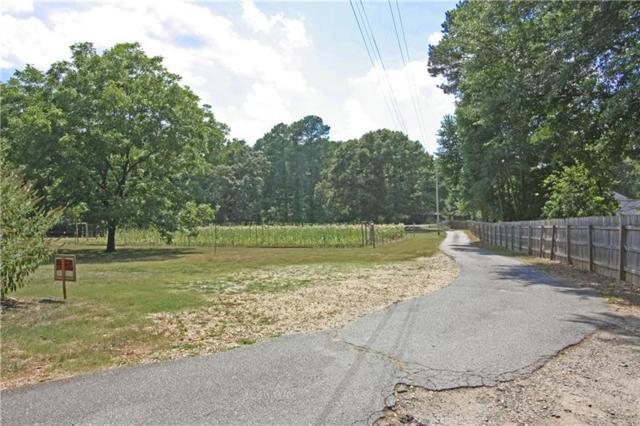 10180 Wooten Road, Roswell, GA 30076 (MLS #5968904) :: Rock River Realty