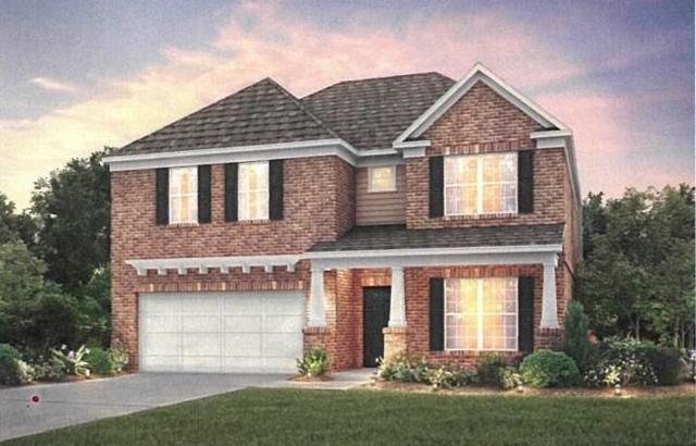 321 Pebblestone Lane, Holly Springs, GA 30115 (MLS #5972488) :: North Atlanta Home Team