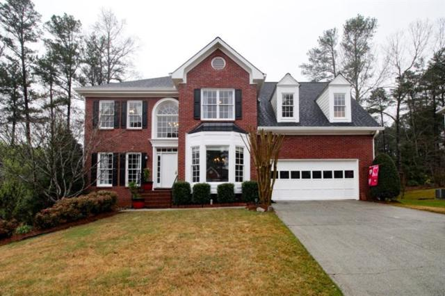 4245 Cedar Bluff Way SW, Lilburn, GA 30047 (MLS #5975005) :: North Atlanta Home Team