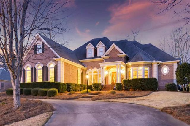 5560 Stoneleigh Drive, Suwanee, GA 30024 (MLS #5981344) :: North Atlanta Home Team