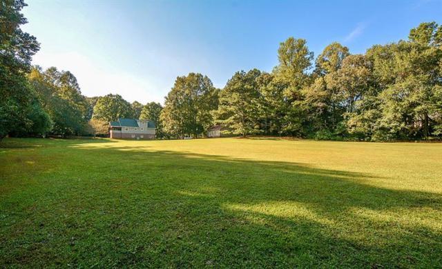 6999 Hickory Flat Highway, Woodstock, GA 30188 (MLS #5983071) :: North Atlanta Home Team